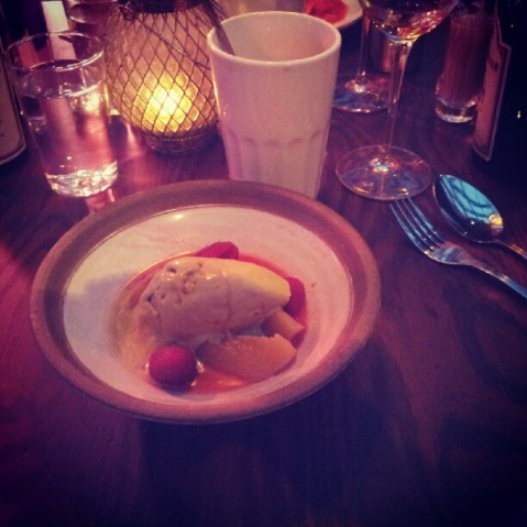 Dessert of white peaches, raspberries, and pistachio ice cream at Trattorian